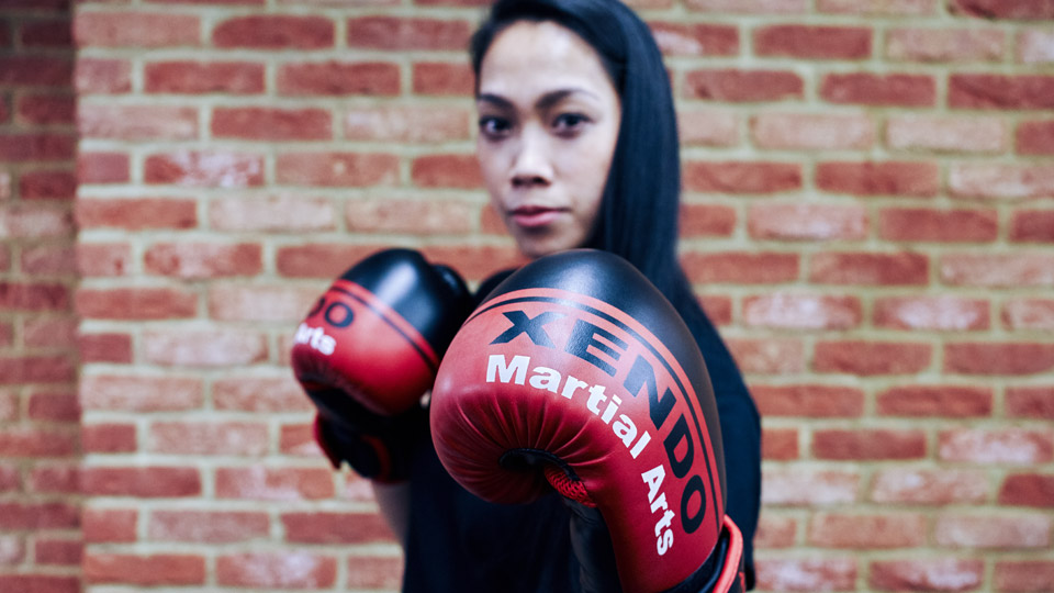 A girl with boxing gloves on image