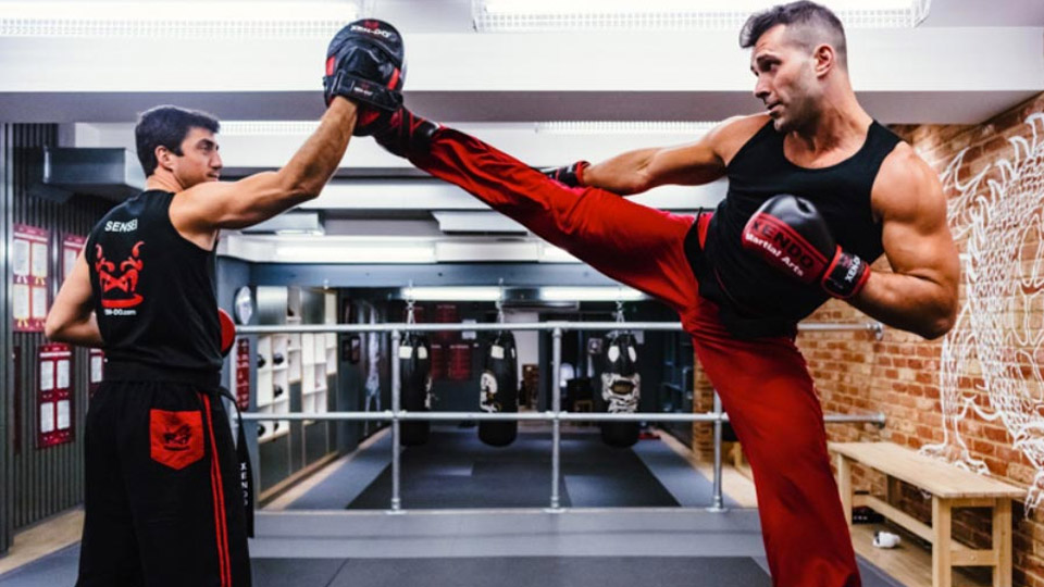 Xen-Do instructor perform a hi-kick while sparring with another image