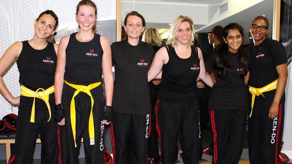 Xen-Do students displying their yellow belts image