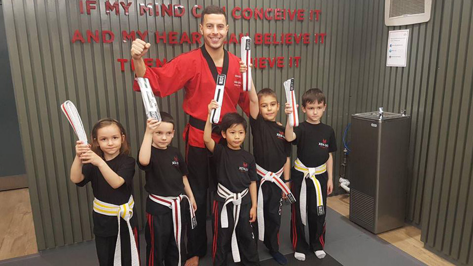 Children at Xen-Do showing their new belts off image