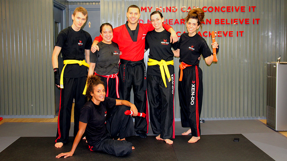 Xen-Do Kickboxing and Martial Arts students after successful yellow, red and orange belt grading