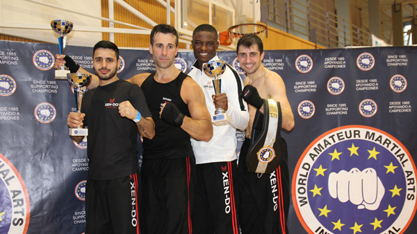 The full-contact fighters, Senseis Levon, Nicolas, Kasheme, with their trophies and Sensei Anthony with the championship belt