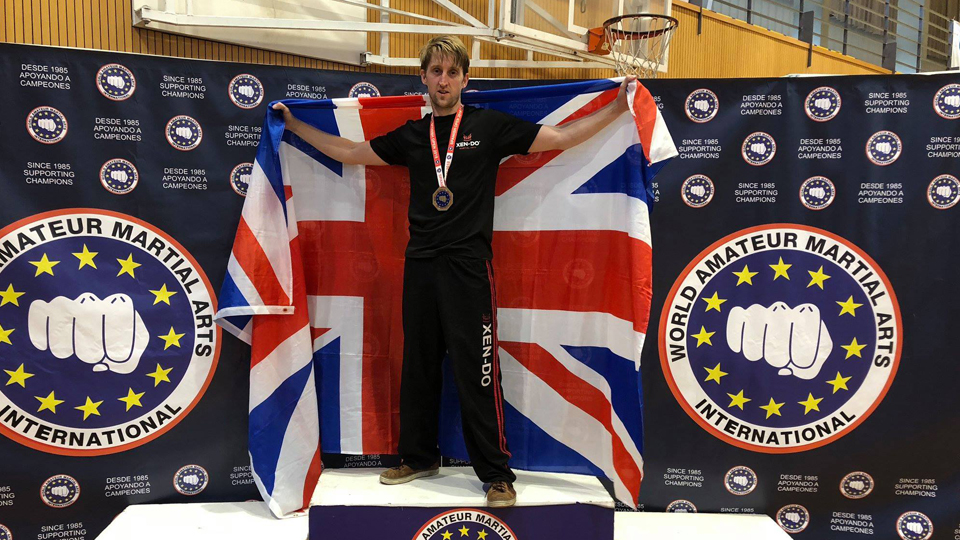The Senseis have endless support from Team GB - Sensei Paul showing off his win after a tough fight