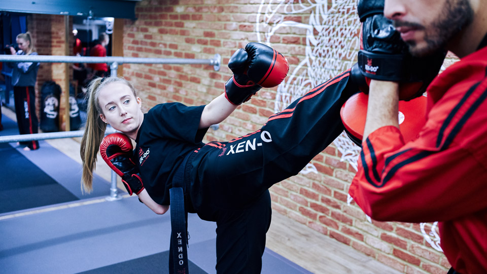 Sensei Lauren does a High kick during sparring